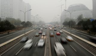 Thick smog driven by car emissions descends on Beijing