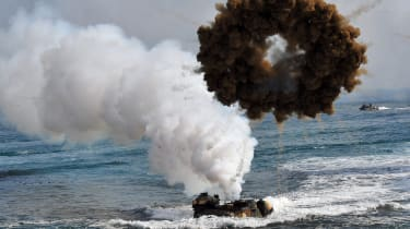 South Korean Marine amphibious assault vehicles land on the seashore during a joint landing operation by US and South Korean Marines in Pohang, 270 kms southeast of Seoul, on March 31, 2014.