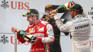 SHANGHAI, CHINA - APRIL 14:Race winner Fernando Alonso (L) of Spain and Ferrari celebrates on the podium with third placed Lewis Hamilton (R) of Great Britain and Mercedes GP following the Ch