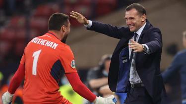 Ukraine head coach Andrey Shevchenko and goalkeeper Georgiy Bushchan