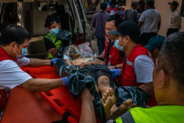 Medics attend to a protester who was shot in Yangon
