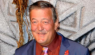 """LONDON, ENGLAND - DECEMBER 01:(MANDATORY CREDIT PHOTO BY DAVE J. HOGAN GETTY IMAGES REQUIRED) Stephen Fry attends """"The Hobbit: The Battle Of The Five Armies""""World Premiere at Odeon Leicester"""