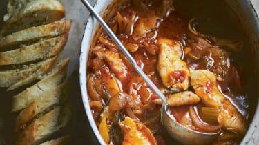 Tomato and fennel fish stew with garlic and oregano bread