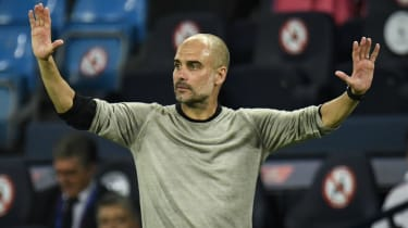 Manchester City manager Pep Guardiola gestures during the 2-1 win against Real Madrid