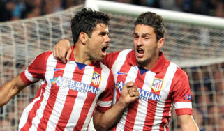 Diego Costa and Koke celebrate Atletico's second goal