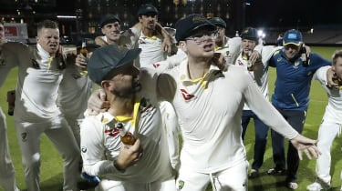 Steve Smith (wearing glasses) celebrates Australia retaining the Ashes