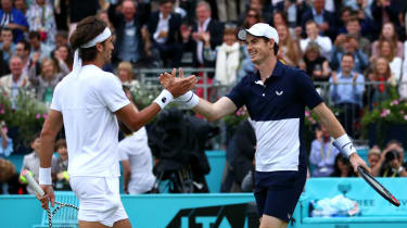 Feliciano Lopez and Andy Murray celebrate their doubles win at Queen's