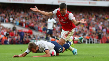 Tottenham striker Harry Kane goes down under a challenge from Arsenal defender Sokratis
