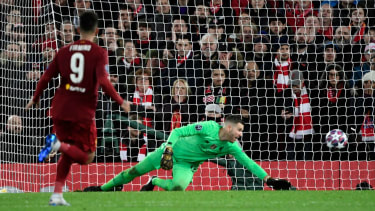 Liverpool goalkeeper Adrian could not keep out Marcos Llorente's first goal for Atletico