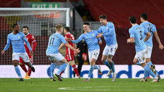 Man City's Phil Foden celebrates his goal against Liverpool at Anfield