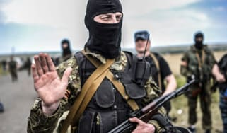 A pro-Russian separatist at the MH17 crash-site in Ukraine