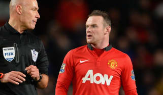 Wayne Rooney and Howard Webb