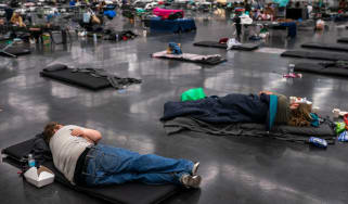 People lying on the ground to cool down from blistering temperatures