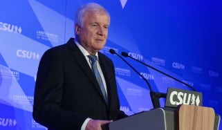 CSU leader Horst Seehofer claims mandate to lead despite heavy losses in state election