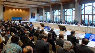General viewof the assembly taking part in the so-called Geneva II peace talks next to UN-Arab League envoy for Syria Lakhdar Brahimi (L) on January 22, 2014 in Montreux. Representatives of S