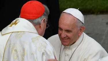 Pope Francis greets Cardinal George Pell at the Vatican