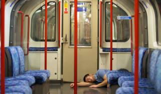 A reveller takes a nap on the first night of London's Underground 24-hour service