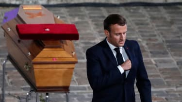 Emmanuel Macron pays his respects by the coffin of Samuel Paty's inside Sorbonne University's, Paris.