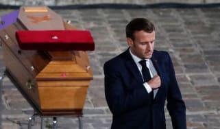 Emmanuel Macron pays his respects by the coffin of Samuel Paty's inside Sorbonne University's, Paris.
