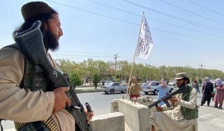 Taliban fighters stand guard outside the Interior Ministry in Kabul