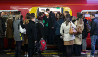 Commuters wrestle for space at Clapham Junction