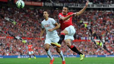Van Persie shoots during Man Utd's 4-0 victory over QPR