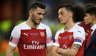 Sead Kolasinac and Mesut Ozil react after Arsenal's 4-1 loss against Chelsea in the Uefa Europa League final in Baku