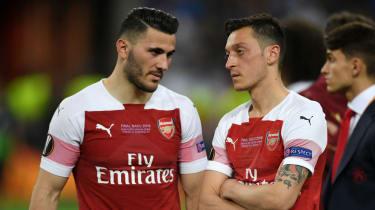 Sead Kolasinac and Mesut Ozil react after Arsenal's 4-1 loss against Chelsea in the Uefa Europa League final in Baku