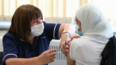 A woman receives her vaccination