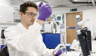 Young Laureate Joseph Cookextracting bacteria and mineralsfrom a water sample.