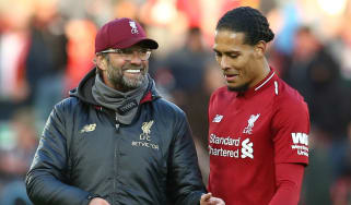 Liverpool's German manager Jurgen Klopp and Dutch defender Virgil van Dijk
