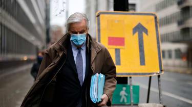 Michel Barnier walks to a conference centre in central London