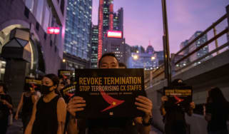 A Protester is seen holding up a placard during a rally in Hong Kong on August 28, 2019. Protester gather in Central in Protest of Cathay Pacific's dismissal of numbers of employee allegedly