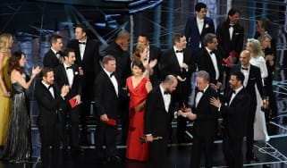 HOLLYWOOD, CA - FEBRUARY 26:(L-R) 'La La Land' producer Jordan Horowitz holds up the winner card reading actual Best Picture winner 'Moonlight' with actor Warren Beatty and host Jimmy Kimmel