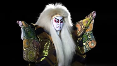 A Kabuki performer dances during the opening ceremony