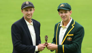 England captain Joe Root and Australia skipper Tim Paine hold the urn ahead of the Ashes