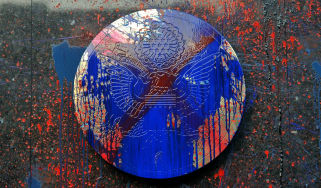 A US embassy seal is vandalised and covered in paint after protests in Manilla in 2012
