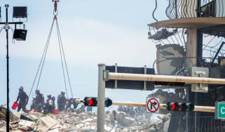 First responders searching debris for signs of life