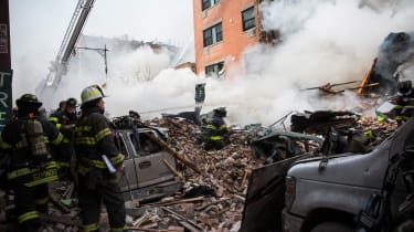 NEW YORK, NY - MARCH 12:Firefighters from the Fire Department of New York (FDNY) respond to a 5-alarm fire and building collapse at 1646 Park Ave in the Harlem neighborhood of Manhattan March