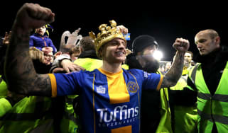 Shrewsbury Town striker Jason Cummings wears an inflatable crown after the 2-2 draw with Liverpool