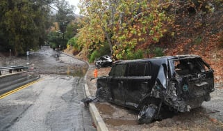 Two cars swept downhill by a powerful mudslide in southern California