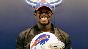 Ex-rugby star Christian Wade poses with a Buffalo Bills helmet
