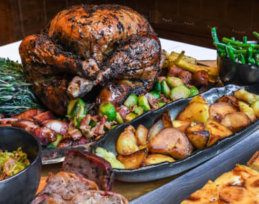 Whole roast turkey surrounded by trimmings