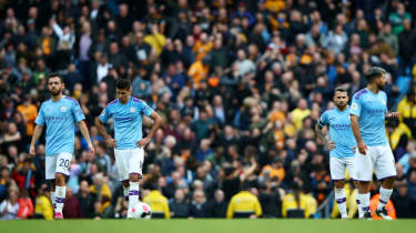 Manchester City players look dejected during the 2-0 loss against Wolves in the Premier League