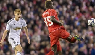 Mario Balotelli passes the ball in the League Cup Fourth Round football match between Liverpool and Swansea City