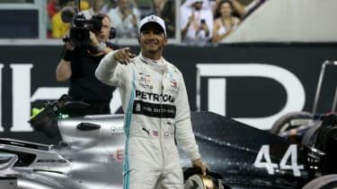 Mercedes driver Lewis Hamilton celebrates winning the 2019 F1 Abu Dhabi Grand Prix