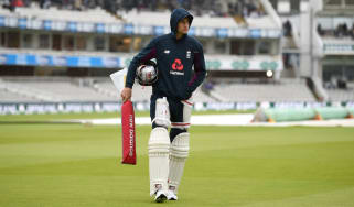 Joe Root waits for the rain to clear at Lord's