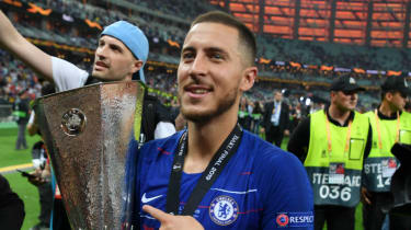Chelsea's Eden Hazard holds the Europa League trophy after the 4-1 win over Arsenal in Baku