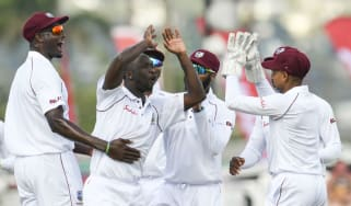 West Indies bowler Kemar Roach (second left) finished with figures of 5-17