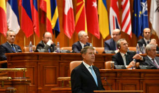 Romania's President Klaus Iohannis delivers a speech in front of NATO's Parliamentary Assembly on Monday